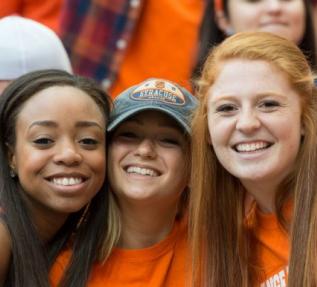 Three SU students dressed in all orange