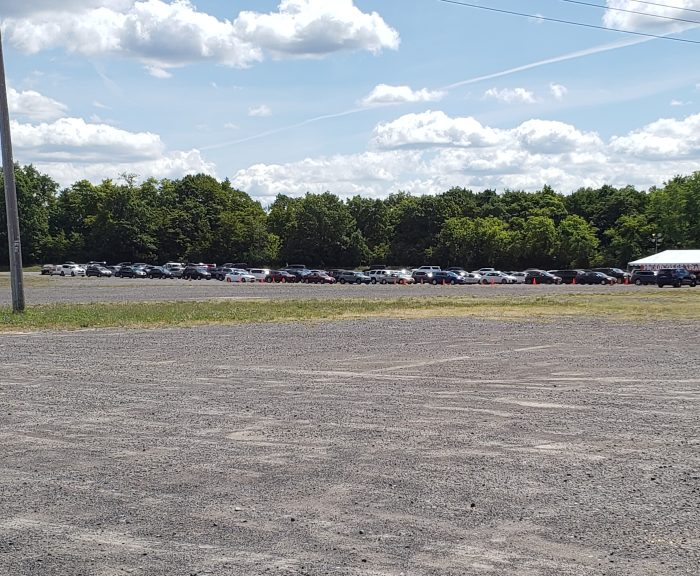 Lines of cars waiting for Syracuse Welcome tents