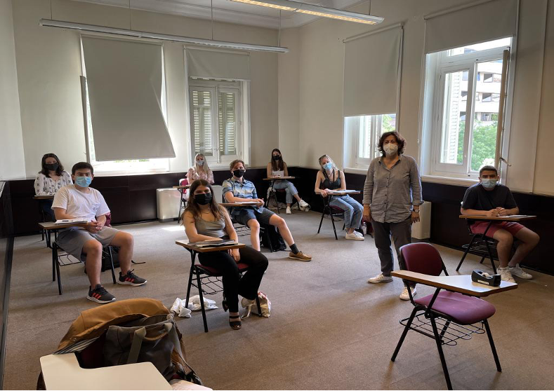 A group of students at the Madrid Center, attending an in-person class.